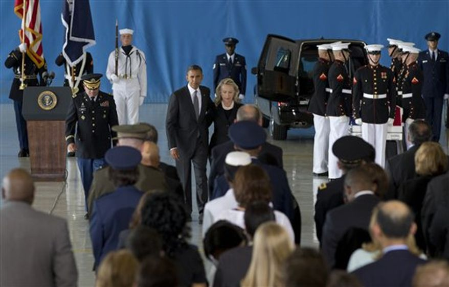 President Obama and Secretary of State Hillary Rodham Clinton walk back to their seats after speaking during the Transfer of Remains Ceremony on Friday, Sept. 14, 2012, at Andrews Air Force Base in suburban Washington. The ceremony marked the return to the United States of the remains of the four Americans killed at the U.S. Consulate in Benghazi, Libya, on Sept. 11. (AP Photo/Carolyn Kaster)