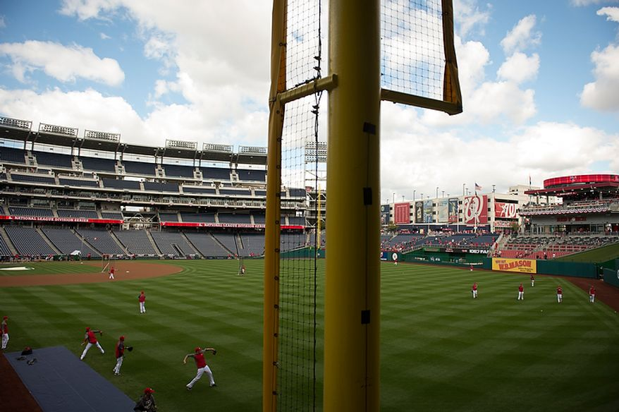 The Washington Nationals take to the field for batting practice before playing the St. Louis Cardinals in game three of the National League Division Series at Nationals Park in Washington on Wednesday, Oct. 10, 2012. (Rod Lamkey Jr./The Washington Times)