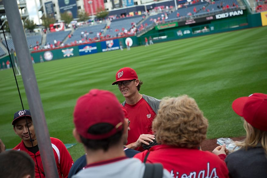 Washington Nationals player Tyler Clippard signs autographs before the Nats play the St. Louis Cardinals in game three of the National League Division Series at Nationals Park in Washington on Wednesday, Oct. 10, 2012. (Rod Lamkey Jr./The Washington Times)