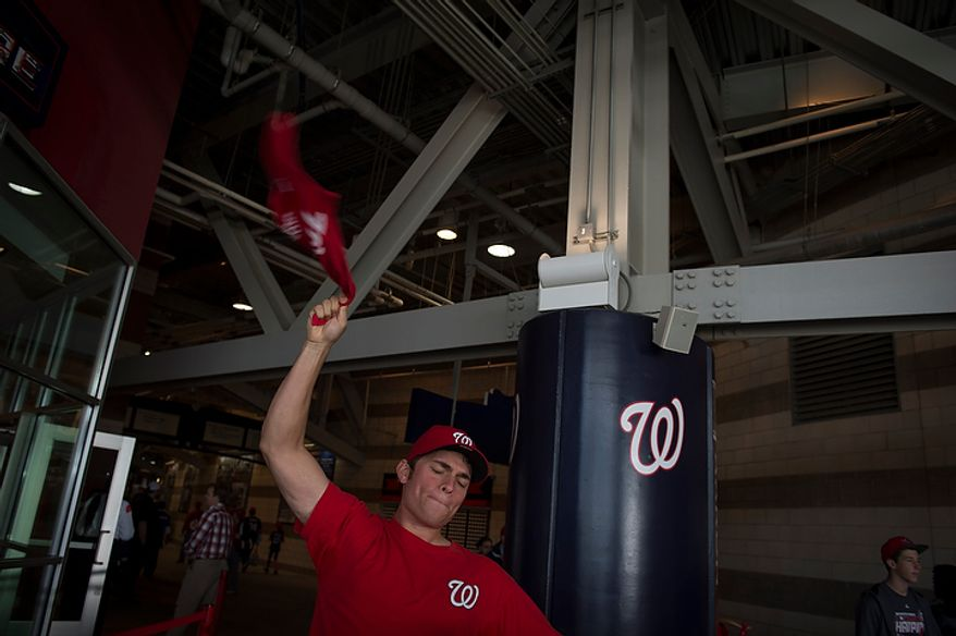 Jake Tomko of Charlottesvile, Va., waves his towel as he arrives before the Washington Nationals play the St. Louis Cardinals in game three of the National League Division Series at Nationals Park in Washington on Wednesday, Oct. 10, 2012. (Rod Lamkey Jr./The Washington Times)