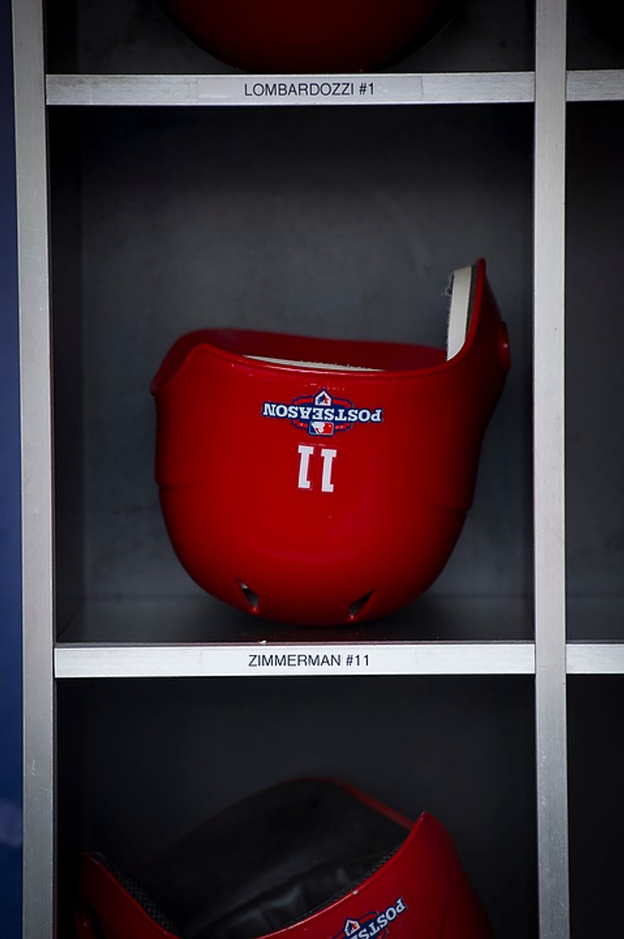 Washington Nationals player Ryan Zimmerman's helmet sits on a shelf before the Nats play the St. Louis Cardinals in game three of the National League Division Series at Nationals Park in Washington on Wednesday, Oct. 10, 2012. (Rod Lamkey Jr./The Washington Times)