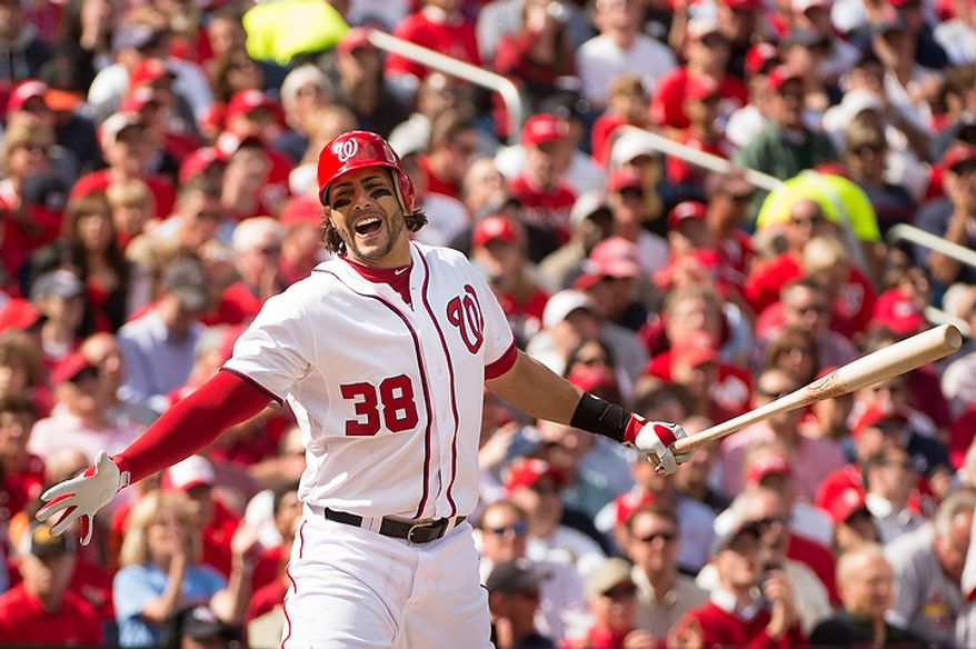 Washington Nationals left fielder Michael Morse (38) shows his frustration as he strikes out to end the first inning as the Washington Nationals play the St. Louis Cardinals in Game 3 of Major League Baseball's National League Division Series at Nationals Park, Washington, D.C., Wednesday, October 10, 2012. (Andrew Harnik/The Washington Times)