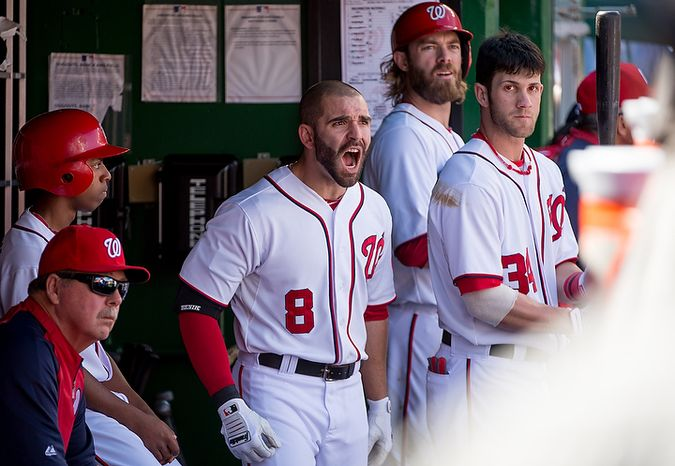 Washington Nationals second baseman Danny Espinosa (8) shows his frustration in the dugout as he was called out at first on a bunt in the second inning as the Washington Nationals play the St. Louis Cardinals in game