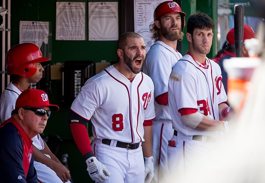 Washington Nationals second baseman Danny Espinosa (8) shows his frustration in the dugout as he was called out at first on a bunt in the second inning as the Washington Nationals play the St. Louis Cardinals in game three of Major League Baseball playoffs at Nationals Park, Washington, D.C., Wednesday, October 10, 2012. (Andrew Harnik/The Washington Times)