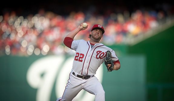 Nationals' relief pitcher Drew Storen delivers in the top of the ninth inning as the Washington Nationals host the St. Louis Cardinals for Game 3 of the National League Division Series at Nationals Park in Washington, D.C., Wednesday, Oct. 10, 2012. (Rod Lamkey Jr./The Washington Times)