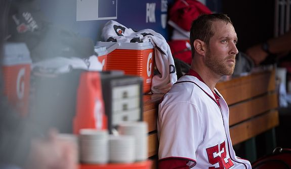 Washington Nationals relief pitcher Ryan Mattheus (52) sits in the dugout after giving up two runs in the eight inning as the Washington Nationals lose to the St. Louis Cardinals 8-0 in game three of the National League Division Series at Nationals Park, Washington, D.C., Wednesday, October 10, 2012. (Andrew Harnik/The Washington Times)