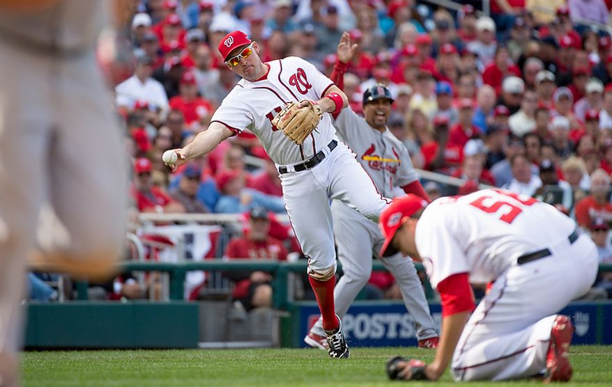 Washington Nationals third baseman Ryan Zimmerman (11) throws out St. Louis Cardinals left fielder Matt Holliday (7) in the seventh inning as the Washington Nationals play the St. Louis Cardinals in game three of the National League Division Series at Nationals Park, Washington, D.C., Wednesday, October 10, 2012. (Andrew Harnik/The Washington Times)