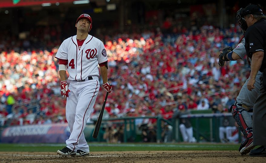 Nationals' Kurt Suzuki reacts after striking out in the bottom of the ninth inning as the Washington Nationals host the St. Louis Cardinals for Game 3 of the National League Division Series at Nationals Park in Washington, D.C., Wednesday, Oct. 10, 2012. (Rod Lamkey Jr./The Washington Times)