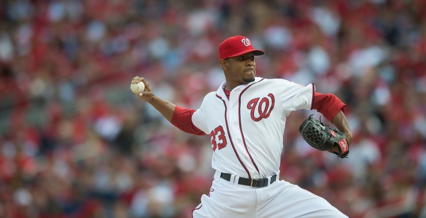 Nationals' Edwin Jackson delivers in the top of the first inning as the Washington Nationals host the St. Louis Cardinals for Game 3 of the National League Division Series at Nationals Park in Washington, D.C., Wednesday, Oct. 10, 2012. (Rod Lamkey Jr./The Washington Times)