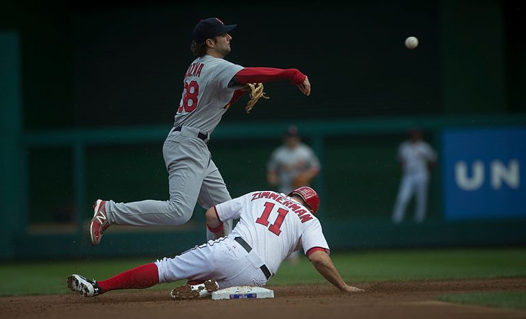 Nationals' Ryan Zimmerman is tagged in a force out at second base by Cardinals' Pete Kozma in the bottom of the first inning as the Washington Nationals host the St. Louis Cardinals for Game 3 of the National League Division Series at Nationals Park in Washington, D.C., Wednesday, Oct. 10, 2012. (Rod Lamkey Jr./The Washington Times)