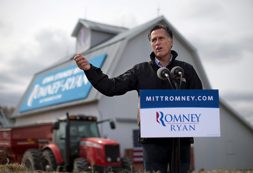Republican presidential candidate Mitt Romney speaks during a campaign rally on Tuesday, Oct. 9, 2012, in Van Meter, Iowa. (AP Photo/Evan Vucci)