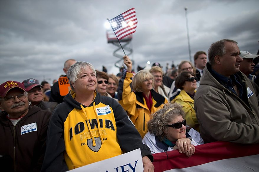 Supporters of Republican presidential candidate Mitt Romney listen to him speak during a campaign rally on Tuesday, Oct. 9, 2012, in Van Meter, Iowa. (AP Photo/Evan Vucci)