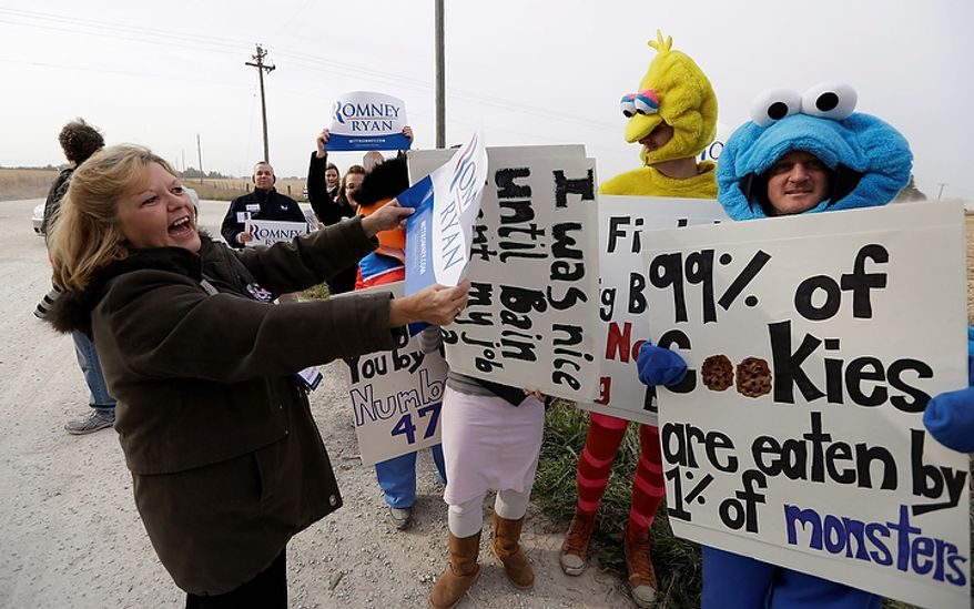 "Romney supporter Jayne Whetstone (left) of Menlo, Iowa, talks with members of Iowa Citizens for Community Improvement Action Fund who are dressed in ""Sesame Street"" costumes outside a campaign stop for Republican presidential candidate Mitt Romney at the Koch family farm on Tuesday, Oct. 9, 2012, in Van Meter, Iowa. (AP Photo/Charlie Neibergall)"