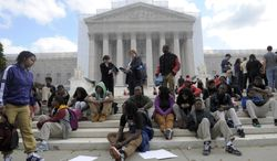 Supporters of the University of Texas rally outside the U.S. Supreme Court in Washington on Wednesday, Oct. 10, 2012, as the high court takes up a challenge to the university's program that considers race in some college admissions. (AP Photo/Susan Walsh)
