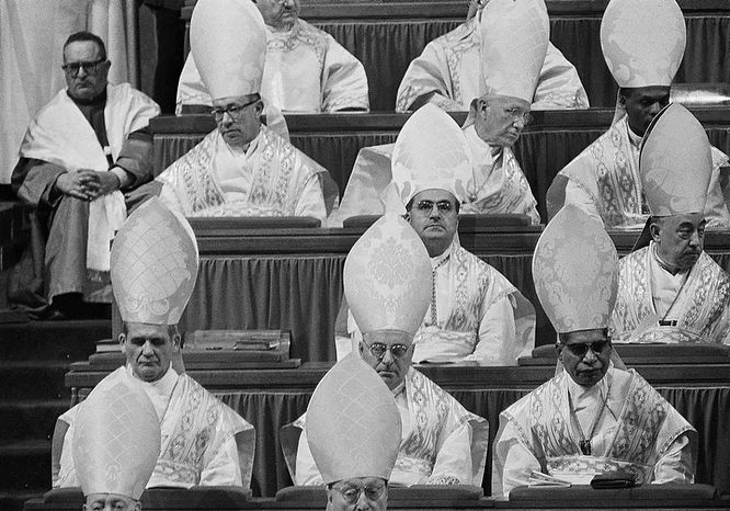 Cardinals seated in St. Peter's Basilica as they attend the solemn opening ceremony of the second session of the Ecumenical Council , Sept. 29, 1963.  Top row, left to right: Cardinal Jose Humberto Quintero, Archbishop of Caracas; Cardinal Joseph Elmer Ritter, Archbishop of Saint Louis, Missouri; Cardinal Laurean Rugambwa, Bishop of Bukoba, Tanganyika.  Middle row:  Cardinal Julius Doepfner of Munich And Freisling; Cardinal Jose M. Bueno y Monreal, Archbishop of Seville. Bottom row:  Cardinal Paul Emile Leger, Archbishop of Montreal; Cardinal Giuseppe Ferretto, Italian member of the Vatican Curia; and Cardinal Valerian Gracias, Archbishop of Bombay, India.  (AP Photo)