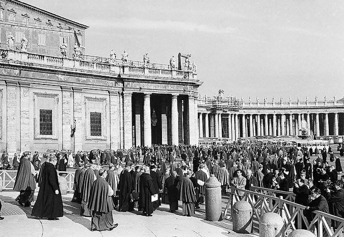 Council fathers leave St. Peter's Basilica in Vatican City, Dec. 2, 1963 at the conclusion of the final working session of the current Ecumenical Council.  Pope Paul VI sent word to the Council that he would is