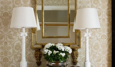 Photograph provided by Angie Seckinger  In a foyer that lacks natural lighting, table lamps can add welcoming light, says Kelley Proxmire of Kelley Interior Design in Bethesda. A mirror can be used to reflect additional light.