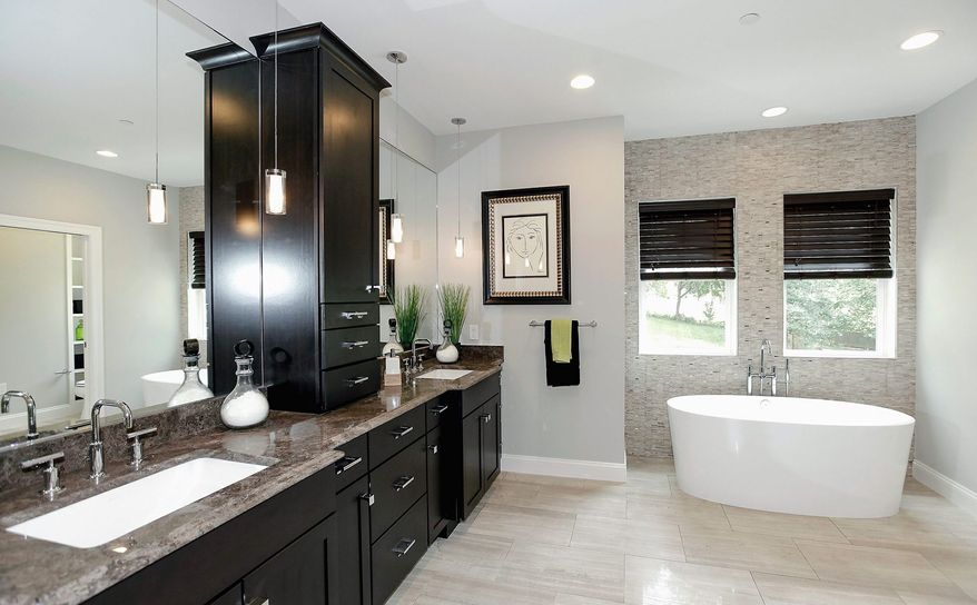 The master bath has Italian marble flooring, a whirlpool tub, an oversized shower with multiple shower heads, and a double-sink vanity.