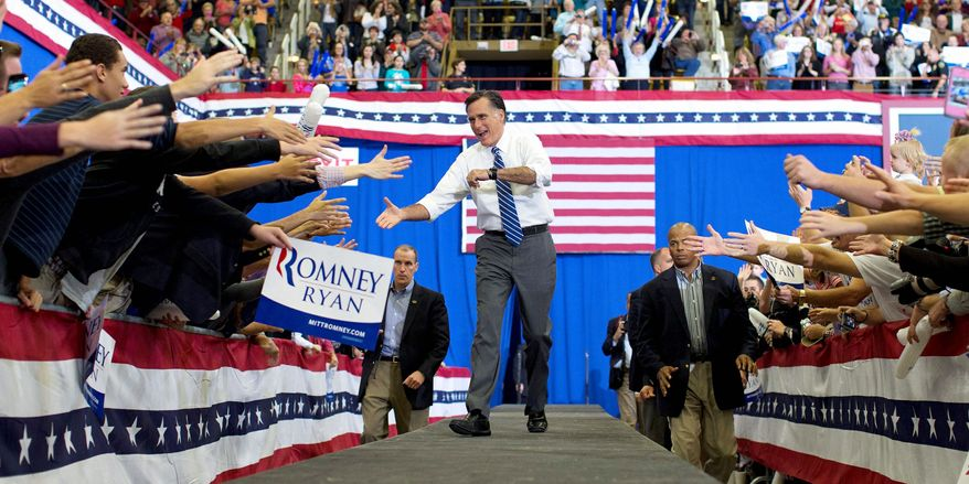 Former Massachusetts Gov. Mitt Romney, the Republican presidential nominee, greets excited supporters as he arrives for a campaign rally at the U.S. Cellular Center in Asheville, N.C., on Thursday. (The Associated Press)
