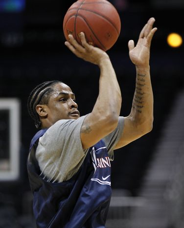 Virginia's Jontel Evans shoots during NCAA college Atlantic Coast Conference basketball practice in Atlanta, Wednesday, March 7, 2012. Virginia is to play the winner of Thursday's North Carolina State-Boston College game in a second-round game on Friday. (AP Photo/John Bazemore)