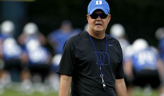 Duke coach David Cutcliffe watches during the team's first NCAA college football practice of the season in Durham, N.C., Monday, Aug. 6, 2012. (AP Photo/Gerry Broome)