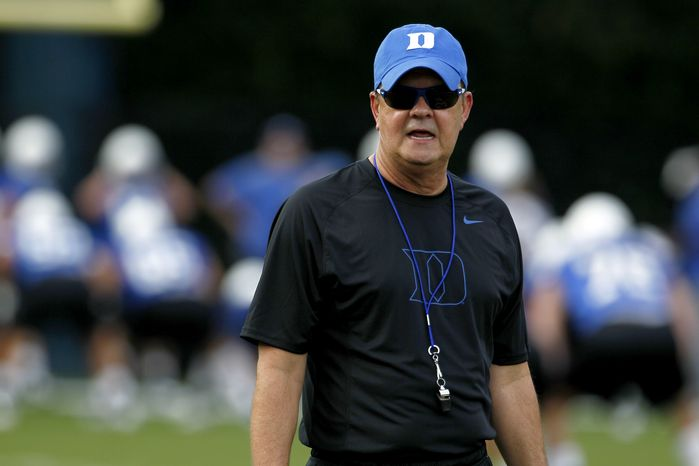 Duke coach David Cutcliffe watches during the team's first NCAA college football practice of the season in Durham, N.C., Monday, Aug. 6, 2012. (AP