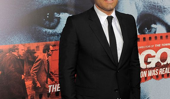 """Ben Affleck, director, producer and a cast member of """"Argo,"""" poses at the premiere of the film at The Academy of Motion Picture Arts & Sciences on Thursday, Oct. 4, 2012, in Beverly Hills, Calif. (Photo by Chris Pizzello/Invision/AP)"""
