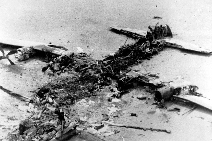 The scorched wreckage of an American C-130 Cargo aircraft lies in the Iranian desert of Dasht-E-Kavir, approximately 500 kilometers from Tehran, Iran on April 27, 1980. The mission  to free 50 American hostages from the U.S. Embassy in Tehran was aborted due to equipment failure. The plane collided with a U.S. helicopter and eight servicemen were killed. (AP Photo)
