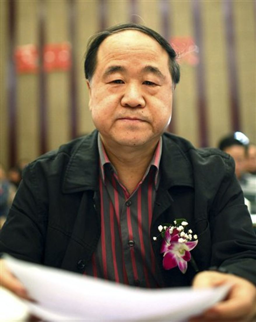 In this photo taken Sunday, March 25, 2012, Chinese writer Mo Yan attends a novel writing competitions as a judge, in Haikou in south China's Hainan province. Mo has won the Nobel Prize in literature on Thursday, Oct 11, 2012. (AP Photo)