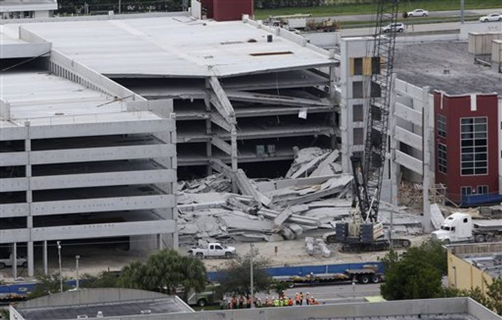 A five-story parking garage is shown after it collapsed at Miami-Dade College, Wednesday, Oct. 10, 2012, in Doral, Fla., killing one worker and trapping two others in the rubble, officials said. Several other workers were hurt, including one rescued from the debris. (AP Photo/Lynne Sladky)