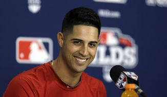 Nationals lefty Gio Gonzalez sports his new haircut done by Hugo Tandron at a National League Division Series press conference. (AP Photo/Jeff Roberson)