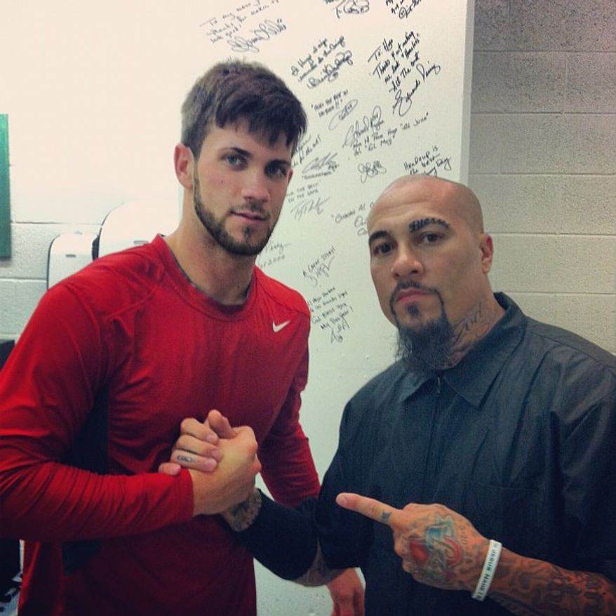 Nationals outfielder Bryce Harper poses with barber Hugo Tandron earlier this season. (Courtesy of Hugo Tandron)