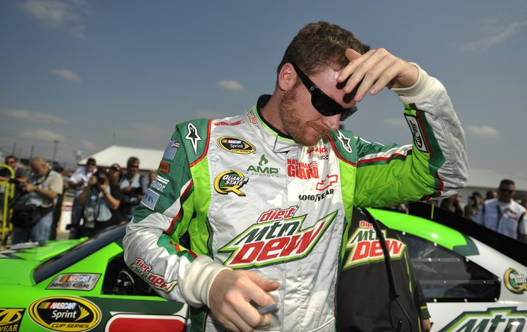 NASCAR driver Dale Earnhardt Jr., wipes his brow Oct. 6, 2012, after qualifying at Talladega Superspeedway in Talladega, Ala. The drivers were qualifying for the Sunday running of the NASCAR Sprint Cup Series auto race. (Associated Press)