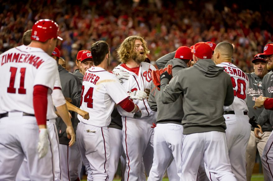 Washington Nationals right fielder Jayson Werth (28) celebrates with teammates after hitting a walk off home run in the bottom of the ninth inning to beat the St. Louis Cardinals 2-1 in game four of the National League Division Series at Nationals Park, Washington, D.C., Thursday, October 11, 2012. (Andrew Harnik/The Washington Times)
