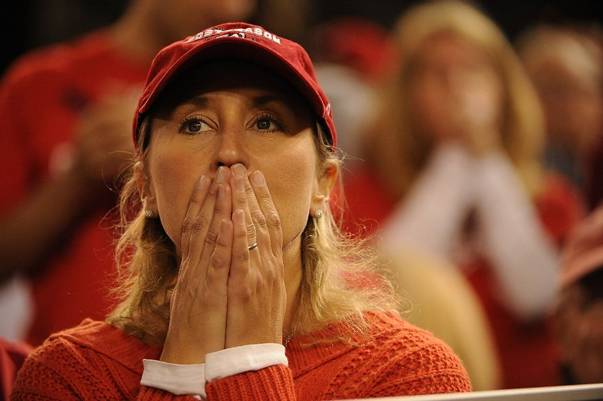 A Nats fan shows the tension of a 1-1 tie game in the ninth inning of Game 4 of the National League Division Series between the Washington Nationals and the St. Louis Cardinals at Nationals Park, Thursday, October 11, 2012. (Andrew Harnik/The Washington Times)