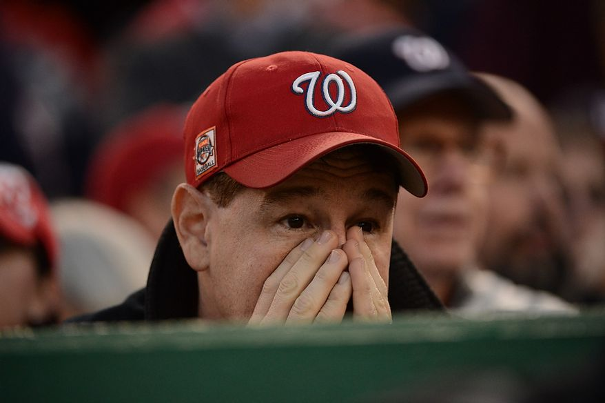 A Nats fan is the face of the tension of a 1-1 extra inning game in Game 4 of the National League Division Series between the Washington Nationals and the St. Louis Cardinals at Nationals Park, Thursday, October 11, 2012. (Andrew Harnik/The Washington Times)