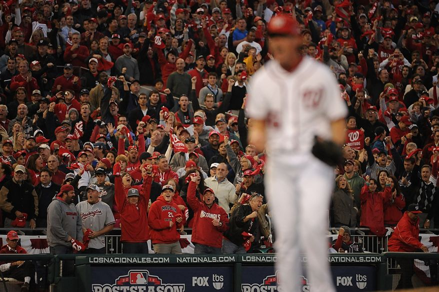 Fans cheer as Washington Nationals relief pitcher Tyler Clippard (36) reacts after striking out the side in the eight inning of Game 4 of the National League Division Series between the Washington Nationals and the St. Louis Cardinals at Nationals Park, Thursday, October 11, 2012. (Andrew Harnik/The Washington Times)