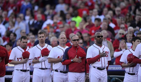 Manager Davey Johnson and the Nationals listen to the National Anthem before Game 4 of the National League Division Series between the Washington Nationals and the St. Louis Cardinals at Nationals Park, Thursday, October 11, 2012. (Preston Keres/Special to The Washington Times)