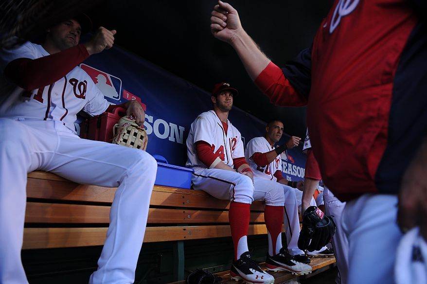 Bryce Harper watches Nationals third baseman Ryan Zimmerman fist bump teammates before the start of Game 4 of the National League Division Series between the Washington Nationals and the St. Louis Cardinals at Nationals Park, Thursday, October 11, 2012. (Andrew Harnik/The Washington Times)