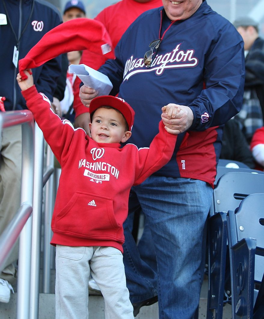 Aiden Bayne, 3, waves his rally towel as he arrives for Game 4 of the National League Division Series between the Washington Nationals and the St. Louis Cardinals at Nationals Park, Thursday, October 11, 2012. (Craig Bisacre/The Washington Times)