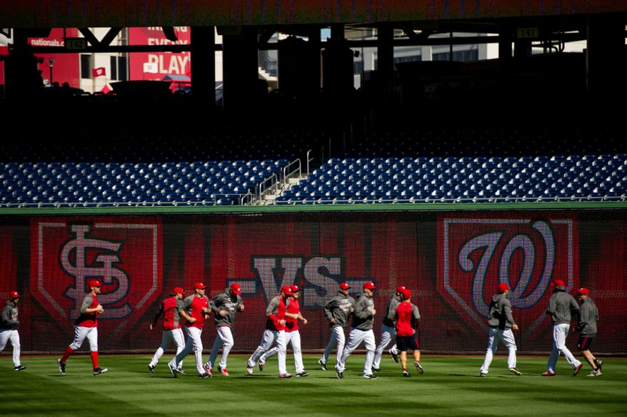 The Washington Nationals warm up in the outfield before playing the St. Louis Cardinals in game four of the National League Division Series at Nationals Park, Washington, D.C., Thursday, October 11, 2012. (Andrew Harnik/The Washington Times)
