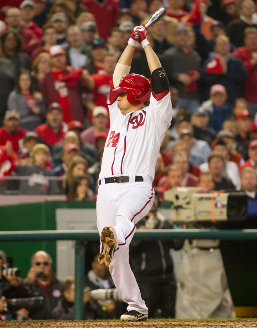 Washington Nationals catcher Kurt Suzuki (24) dodges an errant ball to be walked in the eight inning as the Washington Nationals play the St. Louis Cardinals in game four of the National League Division Series at Nationals Park, Washington, D.C., Thursday, October 11, 2012. (Andrew Harnik/The Washington Times)
