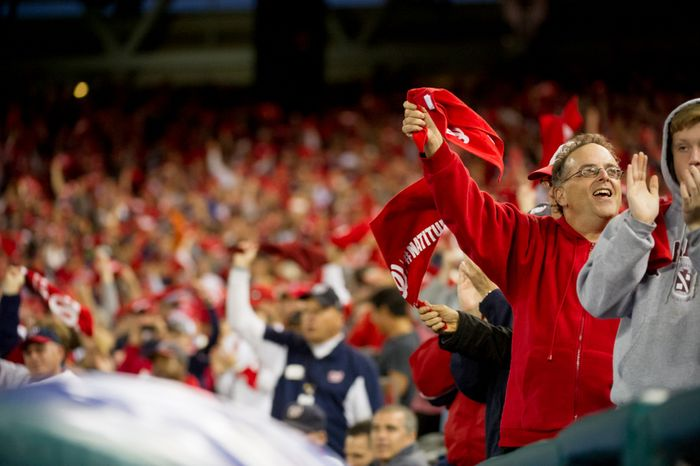 Fans cheer on Washington Nationals relief pitcher Drew Storen (22) as he pitches at the top of the ninth inning as the Washington Nationals play the St. Louis Cardinals in game four of the National League Division Series at Nationals Park, Washington, D.C., Thursday, October 11, 2012. (Andrew Harnik/The Washington Times)