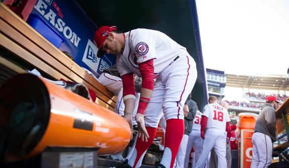 Washington Nationals center fielder Bryce Harper (34) warms his hands in the dugout as the Washington Nationals play the St. Louis Cardinals in game four of the National League Division Series at Nationals Park, Washington, D.C., Thursday, October 11, 2012. (Andrew Harnik/The Washington Times)