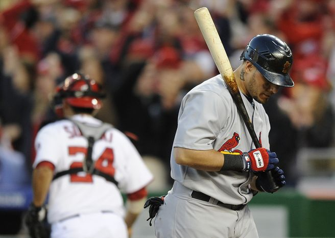 St. Louis Cardinals' Yadier Molina walks off the field after striking out swinging to end the top of the eighth inning of Game 4 of the National League division baseball series against the Washington Nationals on Thursday, Oct. 11, 2012, in Washington. (AP Photo/Nick Wass)