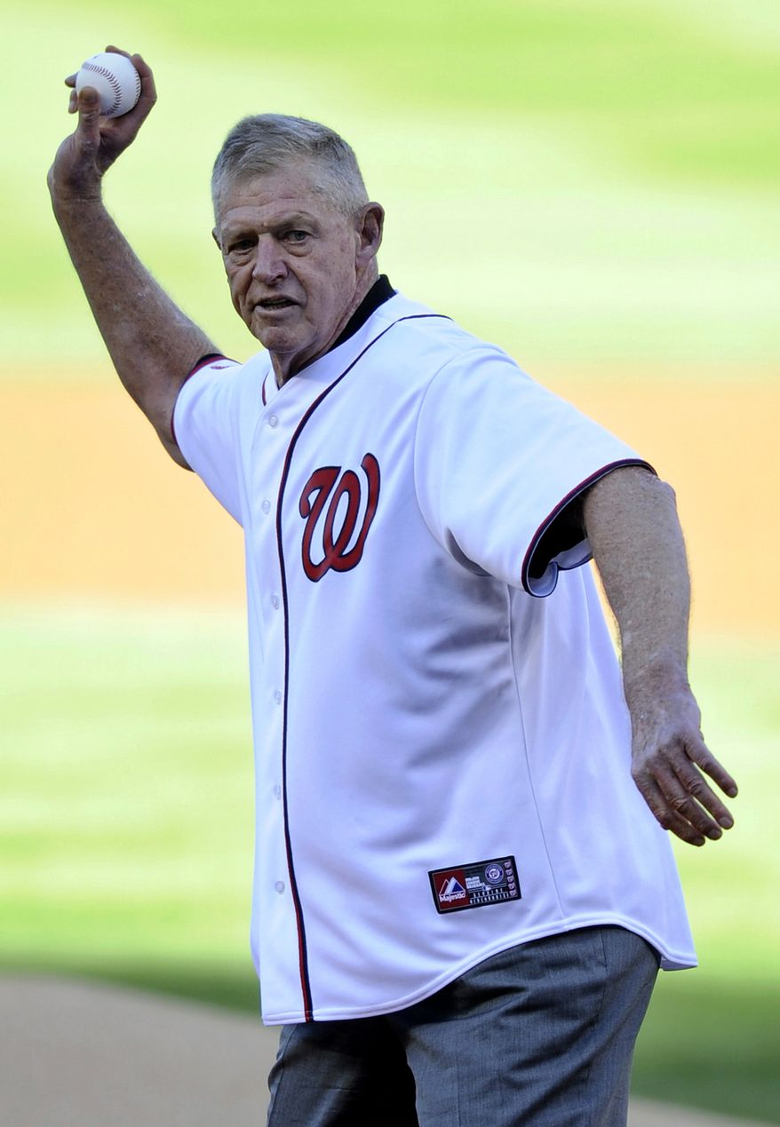 Frank Howard, a former member of the Washington Senators, throws out the ceremonial first pitch before Game 4 of the National League division baseball series between the Washington Nationals and the St. Louis Cardinals on Thursday, Oct. 11, 2012, in Washington. (AP Photo/Nick Wass)