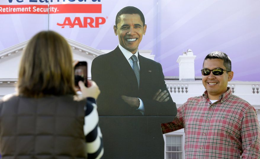 Chris Herron of Danville, Ky., has his picture taken Oct. 11, 2012, with a cutout of President Obama outside the Norton Center on the Centre College campus in Danville, Ky., where the debate between Vice President Joe Biden and Republican vice presidential candidate Paul Ryan was to take place later that day. (Associated Press)