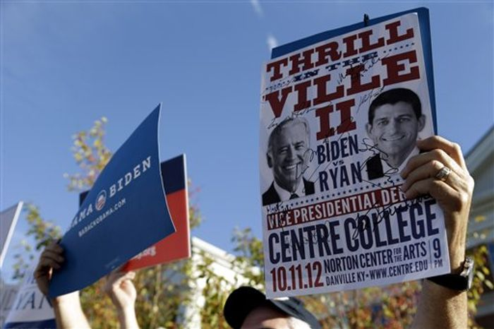 A sign promoting the vice presidential debate is held up at a rally on the Centre College campus, site of the debate, Thursday, Oct. 11, 2012, in Danville, Ky. Vice President Joe Biden will face Republican vice presidential candidate, Rep. Paul Ryan, R-