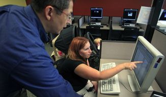 Deanna Aguilera (right), 30, of Salt Lake City receives assistance from employment counselor Frank Trivino while job searching at Workforce Services in Salt Lake City on Friday, Sept. 21, 2012. (AP Photo/Rick Bowmer)
