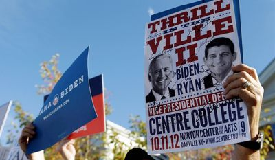 A sign promoting the Vice Presidential debate is held up at a rally on the Centre College campus, site of the debate, Thursday, Oct. 11, 2012, in Danville, Ky. (AP Photo/Eric Gay)